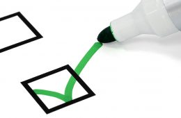 Green marker checks off box on survey