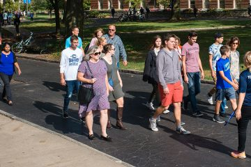 Tour guide lead prospective students and families across campus