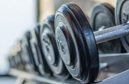 Close up photo of dumbbells on a rack