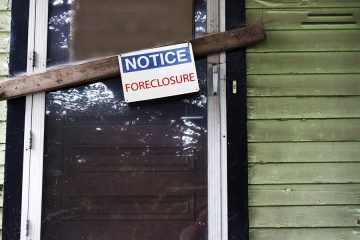 Foreclosure notice on the front door of a house