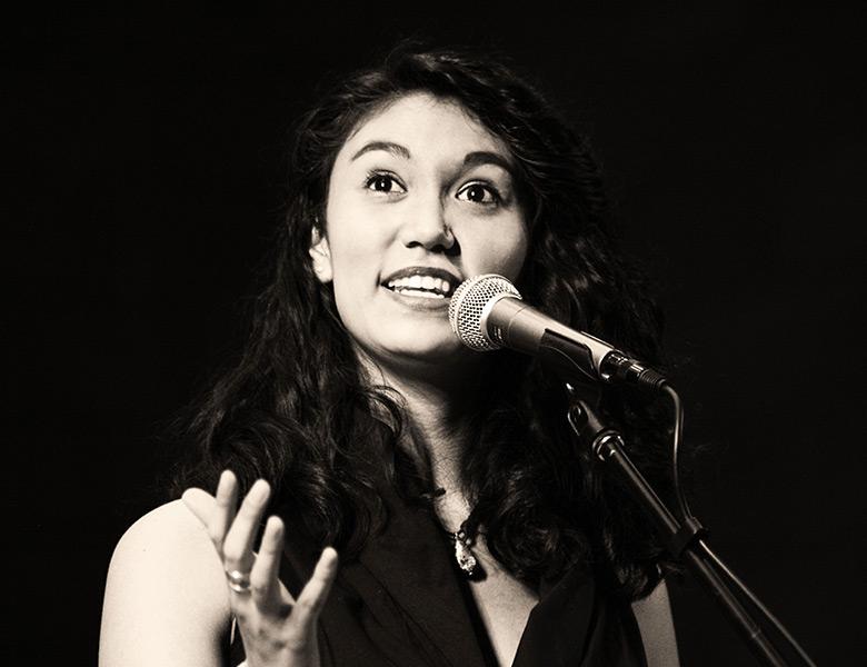 Sarah Kay speaking into microphone