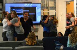 Photo of the CWRU softball team reacting to their NCAA championship bid