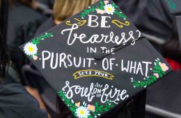 "Top of a commencement cap that says ""Be fearless in the pursuit of what sets your soul on fire"""