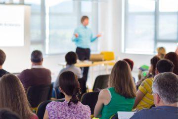 speaker lecturing at a workshop