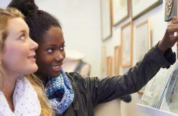 students looking at artwork