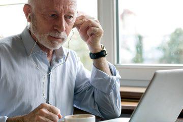 man at laptop computer with headphones