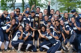Softball team poses with trophy from NCAA Super Regional