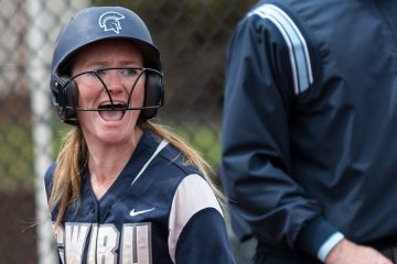 Photo of Katie Wede cheering on the field during a game