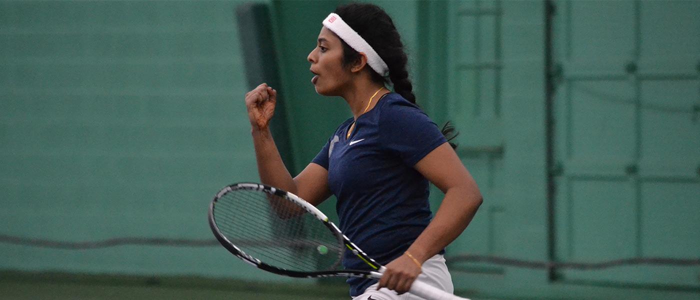 Nithya Kanagasegar celebrates on the tennis court