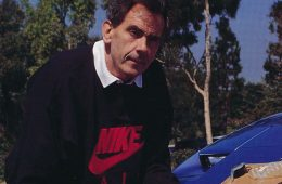 Photo of M. Frank Rudy holding his Nike Air Sole invention.