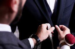 man tailoring a suit