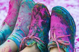gym shoes covered in bright powder from a color run
