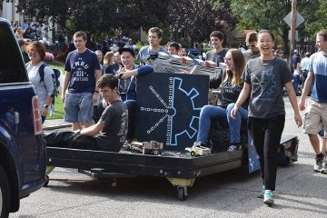 Students in a student organization riding on a float during the 2017 Case Western Reserve University homecoming parade