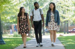 Three students walking across the Case Western Reserve University campus