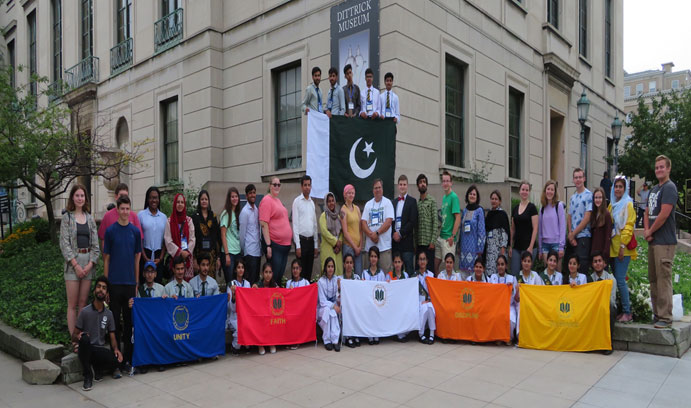 Group of students holding Students in the Learning Streams International program holding Flags of Unity, Faith, Discipline and Tolerance