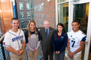 Jim Wyant with student athletes