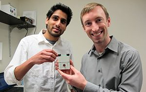 Punkaj Ahuja (left) and Patrick Leimkuehler (right) with a functional prototype blood test analyzer.