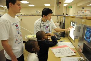 Dental Medicine students show children x-rays