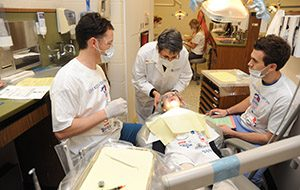 Dentists provide care to child