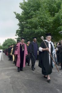 Commencement procession featuring president Agnar Pytte, congressman Louis Stokes, and university marshal Patricia Kilpatrick in 1991.