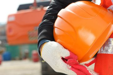 construction worker holding a construction hat