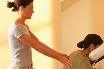 A person sitting and getting a massage