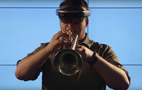 A student playing the trumpet wearing a HoloLens
