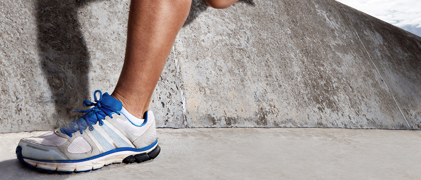 Picture is focused on a man's shoes as he runs