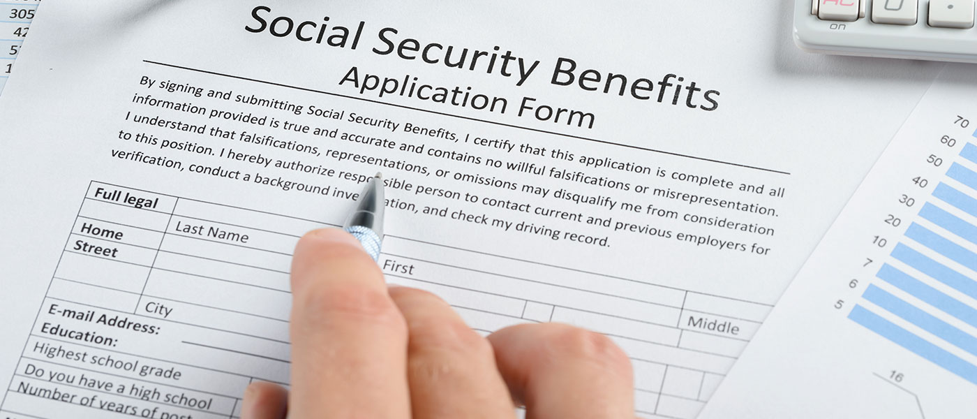 Person filling out social security benefits application