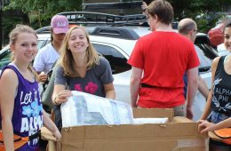 CWRU students helping move boxes