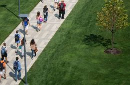 CWRU students walking across the binary walkway in summer