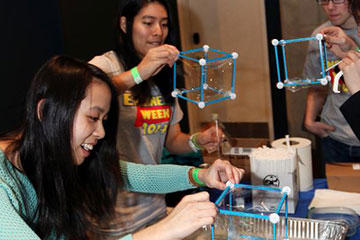 Girl works on project at past engineering carnival