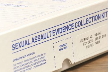 Photo of a Sexual Assault Evidence collection kit box on table