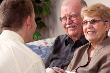 Elderly couple talking to advisor