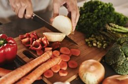 Photo of a person chopping vegetables on a cutting board