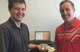 Two Intwine Connect staff employees with a circuit board