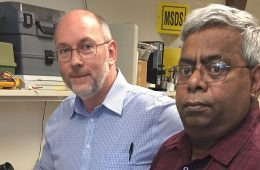 Researchers Kevin Kilgore and Niloy Bhadra in a lab