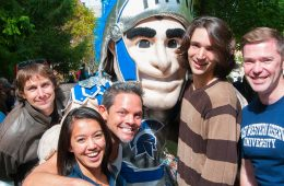 Spartie poses with students at Spartan Tailgate