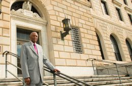 Fred Gray in standing on courthouse steps