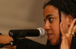 Suzan-Lori Parks speaking at microphone