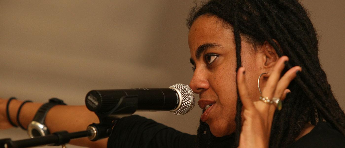 Suzan-Lori Parks speaking at microphone
