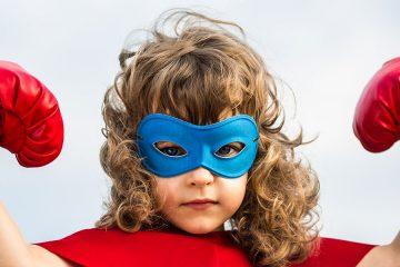 girl dressed up as a superhero