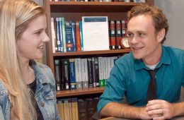 Photo of CWRU law students Katelyn Pierce and Galen Baynes sitting around a table