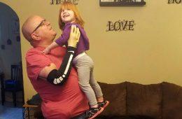 Keith vonderhuevel holding his granddaughter.