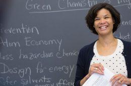 Faculty member teaching in front of chalkboard