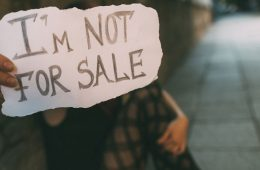 Human traafficking victim holding sign I'm Not for Sale