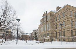 Adelbert Hall exterior with snow covering the grass
