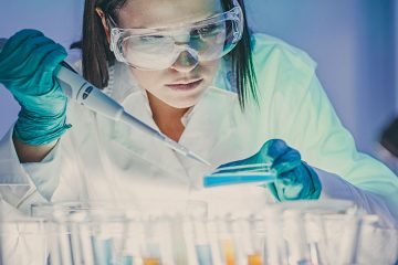 Photo of student working in a lab.