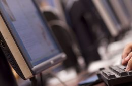 Close up of student typing in computer lab