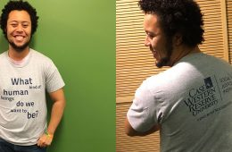 Student wearing Social Justice Institute shirt front and back views